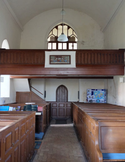 The church balcony and box pews